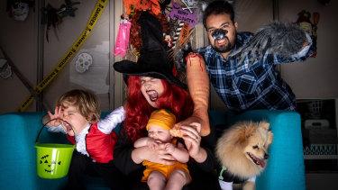 Carly and Fernando Castaneda, with son Charlie, baby Magnolia and Pomeranian Frankie.