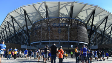 Fans file into the new Bankwest Stadium on Monday.