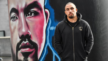 Robert Whittaker, the man and the mural, at Marvel Stadium.