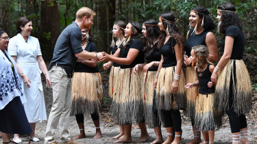 Prince Harry meets members of the Butchulla people during the unveiling of the Queen's Commonwealth Canopy plaque.