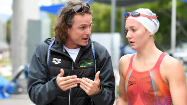 Intense character: Dean Boxall and Ariarne Titmus during a Dolphins team training camp in Cairns last year.