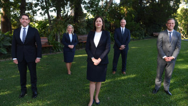 Premier Annastacia Palaszczuk with new or repurposed members of cabinet at Government House on Monday.
