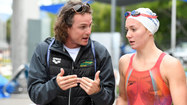 Ariarne Titmus with coach Dean Boxall during a Dolphins team training camp in Cairns last year.