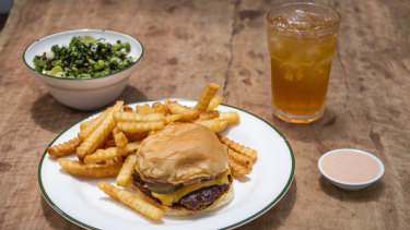 Bush's cheeseburger, with chips and a bowl of greens, has turned into a social media sensation.