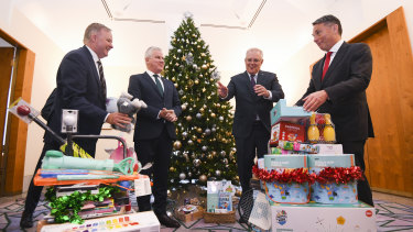 Opposition leader Anthony Albanese,  Deputy Prime Minister Michael McCormack, Prime Minister Scott Morrison and deputy Opposition leader Richard Marles deliver presents at the Kmart Wishing tree launch at Parliament House in early December.