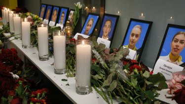Tribute in Kyiv: Flowers and candles are placed in front of portraits of the flight crew members of the Ukrainian 737-800 plane that crashed on the outskirts of Tehran on Wednesday.