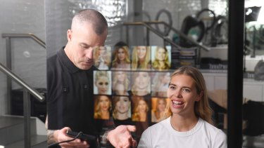 Richard Kavanagh shows the Piiq digital mirror to Phoebe Ghorayeb at Sloan's of Lane Cove.