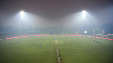 A smoke haze covers the field of play during Sydney Thunder's BBL match against Adelaide Strikers.