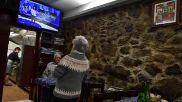 People have lunch in a small bar restaurant as they await the televised last announcement of the Basque armed separatist group ETA, in the small basque village of Hernani, northern Spain.