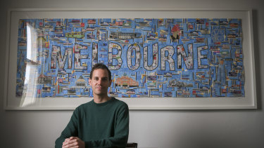 Josh Cohen with his artwork made from Metcards, which came fourth in the Signature of M art prize.