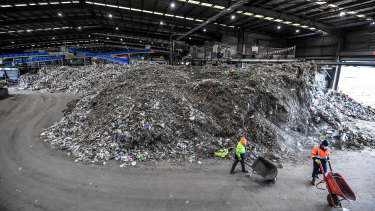 A mountain of contaminated glass that will have to be sent to landfill because it is so mixed in with other products it cannot be separated.