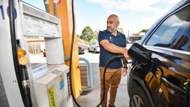 Sabby Soodan, co-founder of Refueler, fills up at SE Fuel in Mount Waverly.