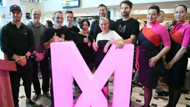 Queensland Innovation Minister Kate Jones (centre) poses for a photo with entrepreneurs and thinkers including Steve Baxter (third left) and former CIA analyst Yael Eisenstat (fifth left), on arrival for the 2018 Myriad Festival in Brisbane.