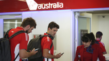 Swans players depart Sydney on a flight to Adelaide on Friday for their first game of the season.