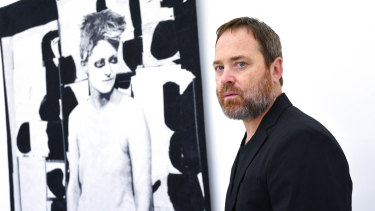 David Noonan with one of his tapestries at Anna Schwartz Gallery this week. ''The figures ... are life-size so that when you see them in the space, you have a bodily relationship to them. ''