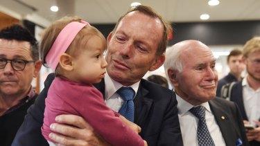 John Howard campaigns alongside Tony Abbott in Sydney on Monday.