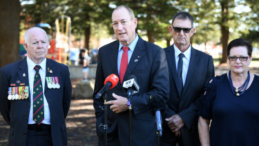 Senator Fraser Anning, centre, is joined by candidate for the seat of Cook Peter Kelly, left, as he speaks to the media at Dunningham Park at Cronulla in Sydney on Friday.