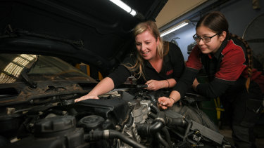 Caroline Langan-Minca, who runs His 'N' Hers Automotive Solutions with her husband, Craig, pictured with her apprentice Janine Nudl.