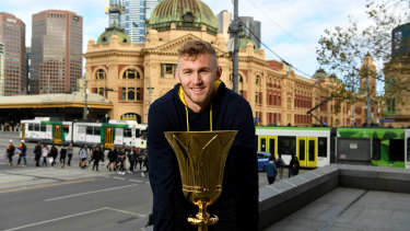 Eyes on the prize: Australian Boomer Jock Landale with the FIBA World Cup trophy in Melbourne on Wednesday.