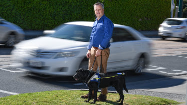 Chris Edwards with his seeing eye dog, Odie.