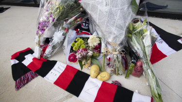 Some fans left potatoes among the collection of tributes.