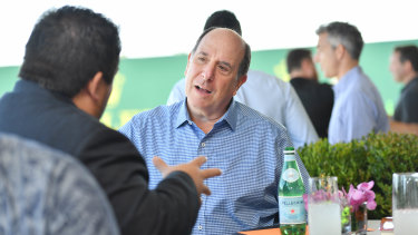 Kronos chief executive and chairman Aron Ain at the Grand Prix with customers.