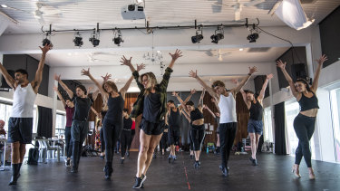 Choreographer Amy Campbell (centre) puts the cast of A Chorus Line through their paces during rehearsals at the East Sydney Community and Arts Centre.