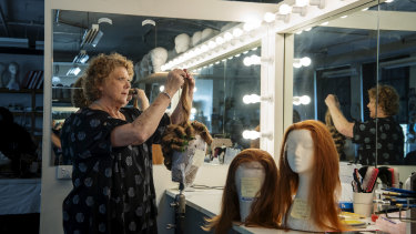Wig technician Lynn Coubrough in the Opera Australia wig storage room.