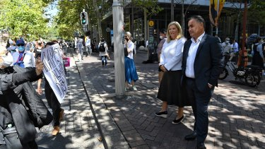 NSW Deputy Premier John Barilaro and Minister for Women Bronnie Taylor observe the protest in Sydney.