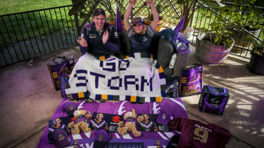 Melbourne Storm fan Bronwyn Smith with her son-in-law Warren Hall prepare to watch the team from home on Saturday night.