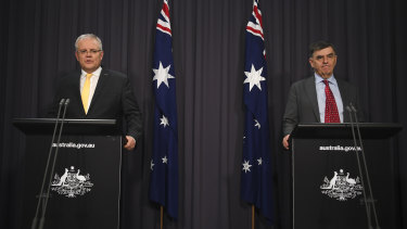 Prime Minister Scott Morrison and Chief Medical Officer Brendan Murphy speak to the media on Tuesday night