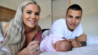 Sammy Stokes, her partner Andy and their baby girl Sunny at their home in Kallangur. The couple made the decision to have a homebirth due to COVID-19 social distancing rules at hospital.