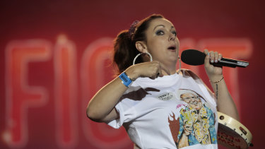 Comedian Celeste Barber addresses the crowd during Fire Fight Australia at ANZ Stadium on Sunday.
