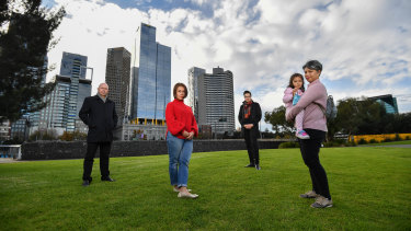 Convener of the East Melbourne Group's planning committee Greg Bisinella, resident Valerie Stroehle,Cr Rohan Leppert and resident Elinor Colaso, with Olivia, four, atBirrarung Marr.