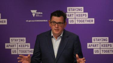 Premier Daniel Andrews speaking to journalists on Monday.