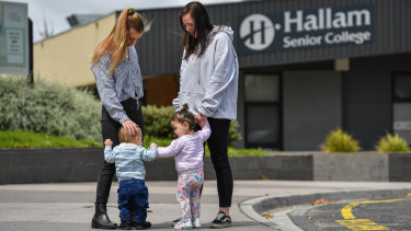 Breanna Cousens, with son Jaxon, and Angel Rees, with daughter Maali, at Hallam Senior Secondary College.