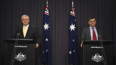 Prime Minister Scott Morrison and Chief Medical Officer Brendan Murphy speak to the media on Tuesday night.