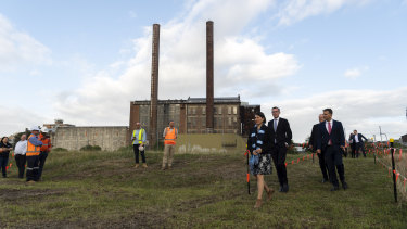 Premier Gladys Berejiklian, Treasurer Dominic Perrottet and Transport Minister Andrew Constance in front of the heritage-listed White Bay Power Station.