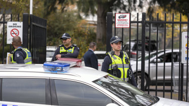 Police at the entrance of Victoria University Secondary College on Wednesday morning.
