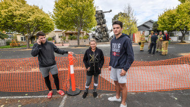 Anna Pace (centre) with son Fred (left) and cousin Daniel Pantalleresco were all in the house when the crane collapsed onto their home.