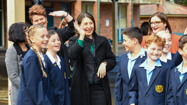 NSW Premier Gladys Berejiklian with students at Panania Public School on Monday.