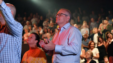 Prime Minister Scott Morrison and wife Jenny sing during an Easter Sunday service at his Horizon Church in Sydney during the 2019 election campaign.