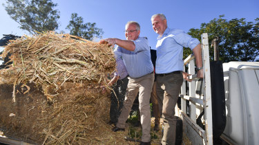 Scott Morrison and Deputy PM Michael McCormack on a drought-affected farm near Dubbo on Saturday.