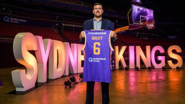 The King is here: Bogut poses with the second Sydney Kings jersey he has been presented with.