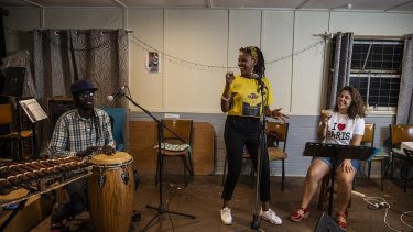 Gladys Namokoyi (centre), with her band rehearsing in Marrickville. was one of the artists and producers pitching ideas to revive Sydney's nightlife.