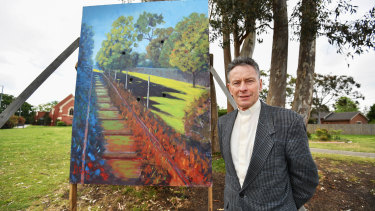 David Powys with his protest painting.