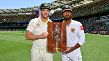 Testing times: Australia captain Tim Paine and Sri Lanka captain Dinesh Chandimal with the Warne-Muralidaran Trophy.