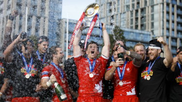 England-bound: Toronto Wolfpack captain Josh McCrone raises the trophy after defeating the Featherstone Rovers in the Million Pound Game in a Betfred Championship rugby league play-off game in Toronto on Saturday.