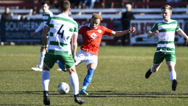Canberra FC's Thomas James looks to shoto.