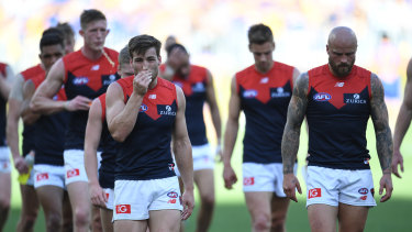 The Demons leave the field after last year's preliminary final loss to West Coast.